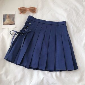 Navy pleated skirt with lace up detail size xs